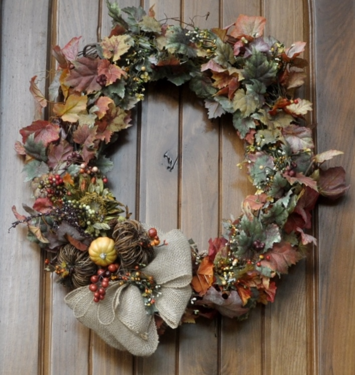 This started with a simple grapevine wreath...after adding a couple of inexpensive garlands and a few fall pics & a burlap bow...it's a perfect welcome to friends and family!