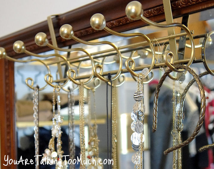 "Over the door storage solution turned into a perfect ""over the mirror"" necklace organizer! http://www.youaretalkingtoomuch.com/2013/02/jewelry-organization-ideas/"