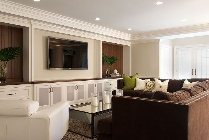 Seating & entertainment center area of basement renovation by Titus Built, LLC.