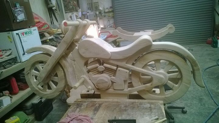 my brother s latest woodwork project that i helped with, diy, woodworking projects, Left side view Just added the dressing parts to make it look like a motorcycle