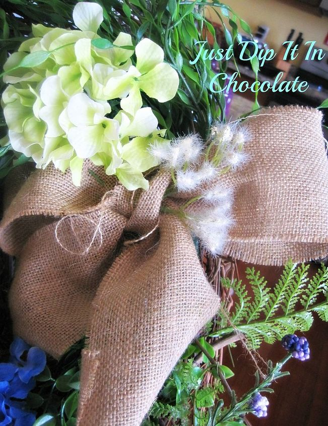 A burlap Bow complements the wreath adding to the natural look.