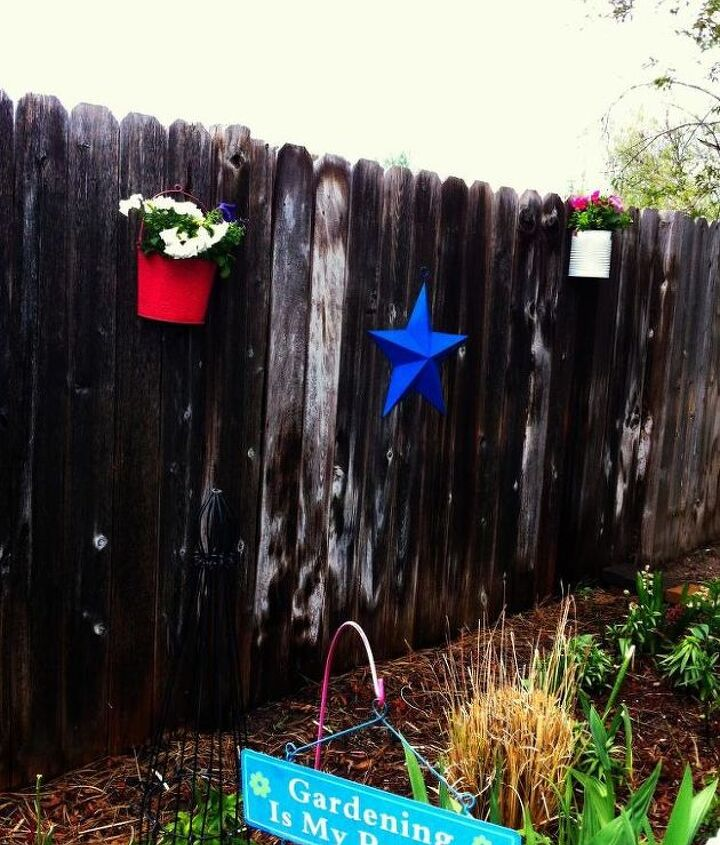 I had 2 same-sized metal planters and they got a coat of pink spray paint.