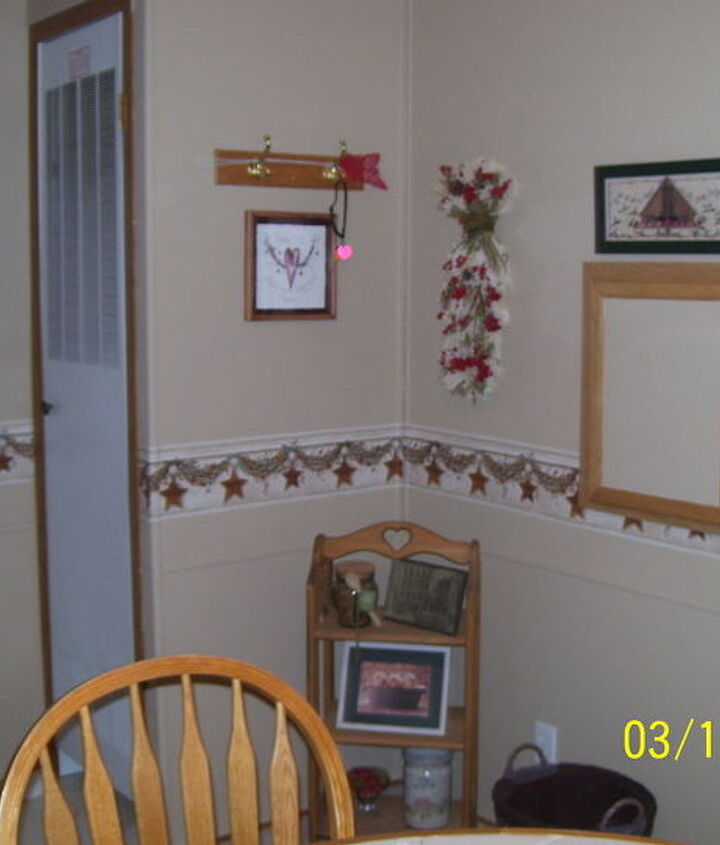 """This wall was a horrid blue/pink/white combo vinyl. UGH. Using Kilz for vinyl walls we were able to cover every inch with a nice easy on the eyes Bisque, add the """"bumper rail"""" and then add all kinds of goodies found at Goodwill."""