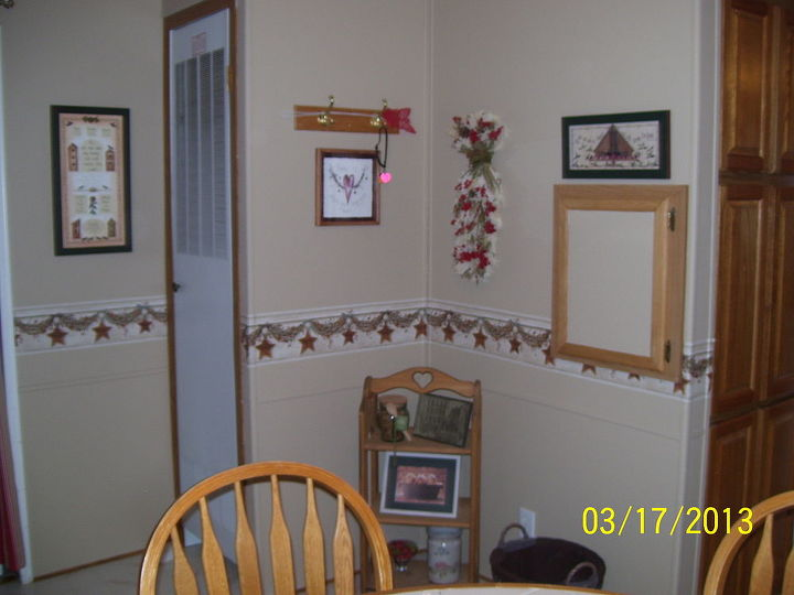 "This wall was a horrid blue/pink/white combo vinyl. UGH. Using Kilz for vinyl walls we were able to cover every inch with a nice easy on the eyes Bisque, add the ""bumper rail"" and then add all kinds of goodies found at Goodwill."