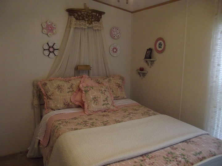 Guest room. The corona over the bed is a shelf painted gold, draped with old lace and fabric.