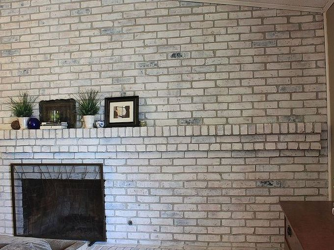 how to white wash your fireplace or brick, concrete masonry, fireplaces mantels, painting, It s a messy project the paint splatters a bit but the results are like night and day I wish I would have done this years ago