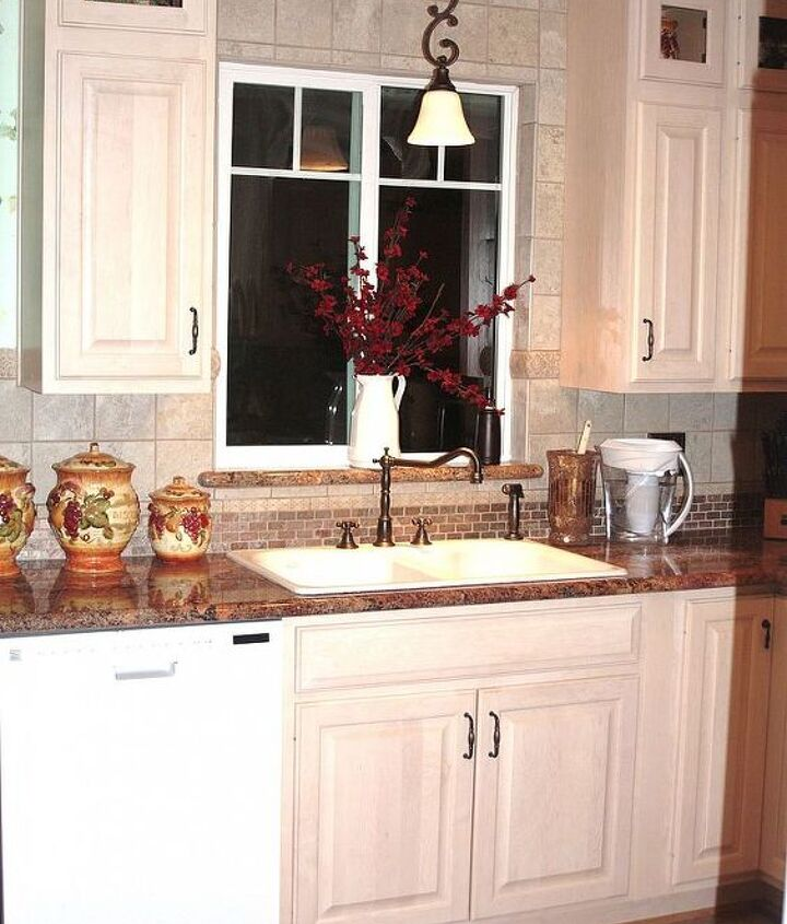 I did the farm style facet set with a double sink and pretty hanging spot light.