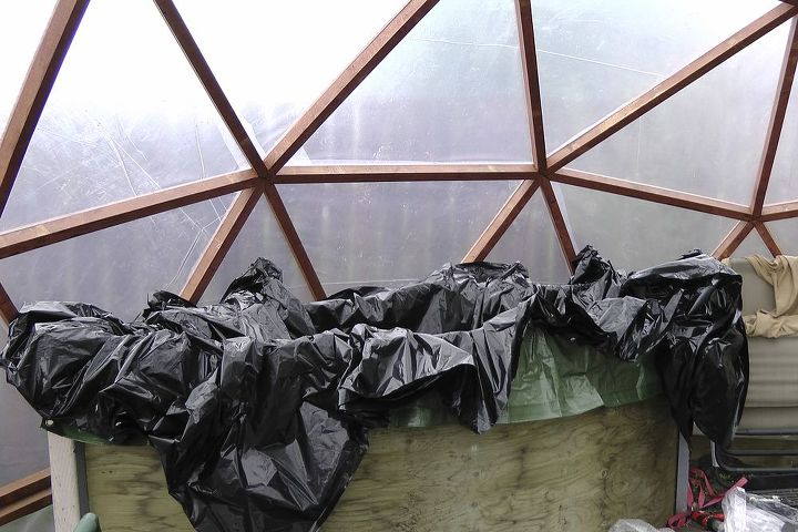 We lined the tank first with tarp, and than with 4 layers of 4 mil black plastic