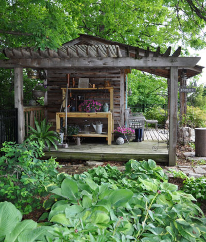 The pool house building with side garden bench area