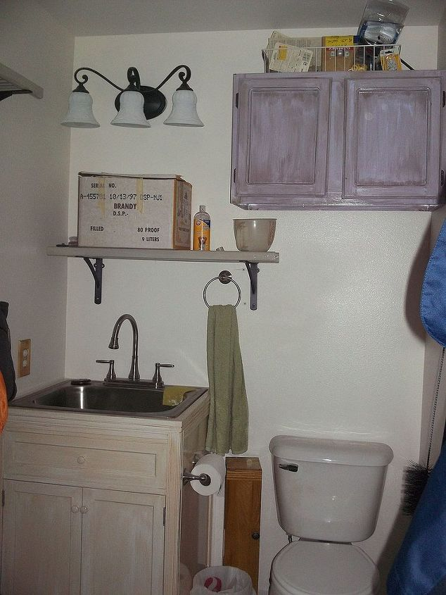 New laundry sink, shelves, light and painted cabinet in the 1/2 bath area