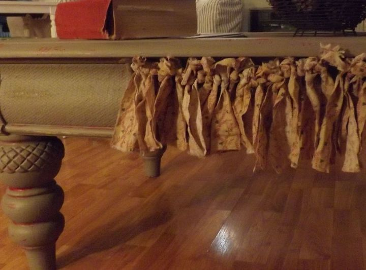 A shabby rag curtain replaces the bad drawer