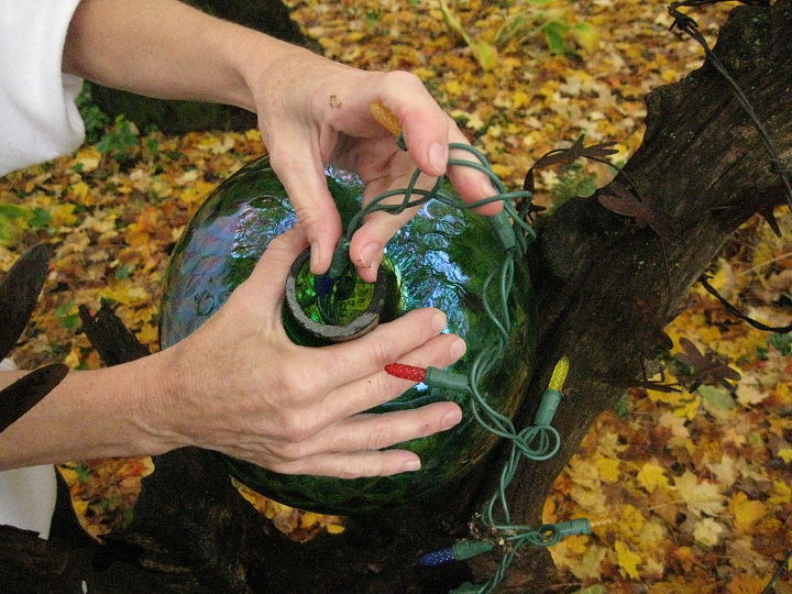 Feeding the lights into the INSIDE of the gazing ball.