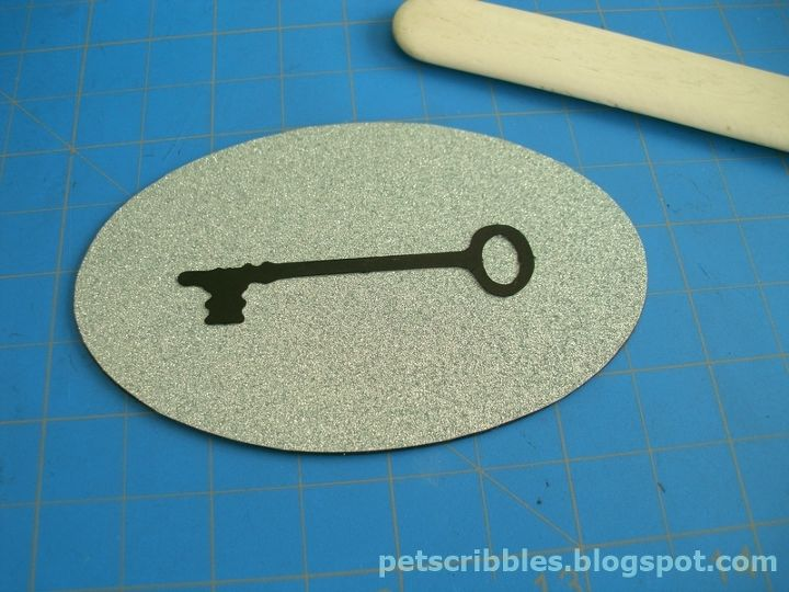 In the meantime, I put together my antique key die cut with pretty aqua glitter paper.