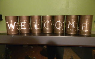 tin can welcome lights, crafts, repurposing upcycling, I spray painted them a dark bronze color when they were done