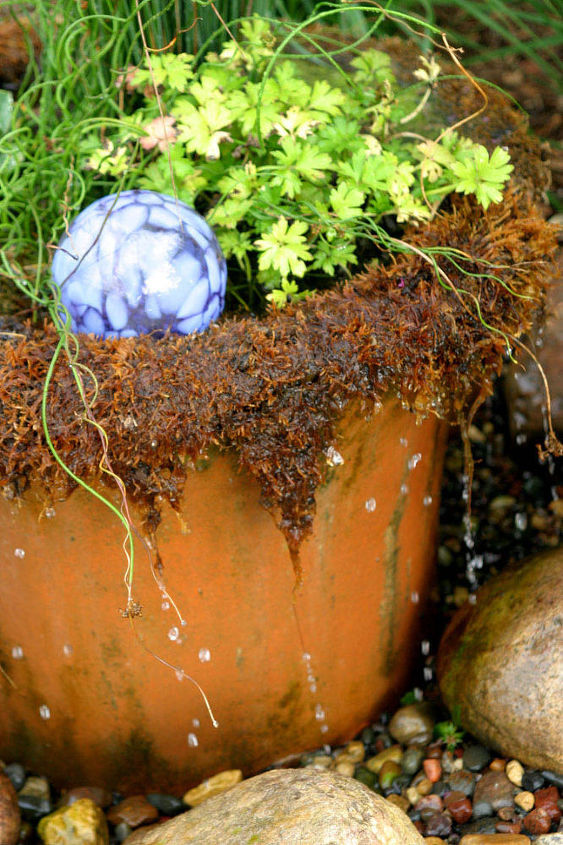 A whimsical dripping pot adds fun to your garden. Add a glass globe for visual interest.
