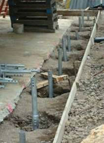 Twenty eight new construction helical piers were driven to the ground to support the new foundation.