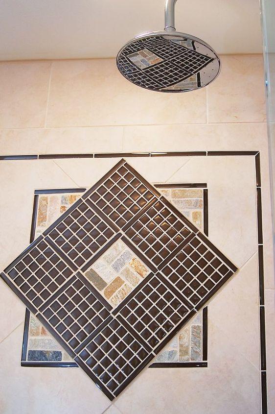 Unique tile design by AK with a little peek at the rain showerhead