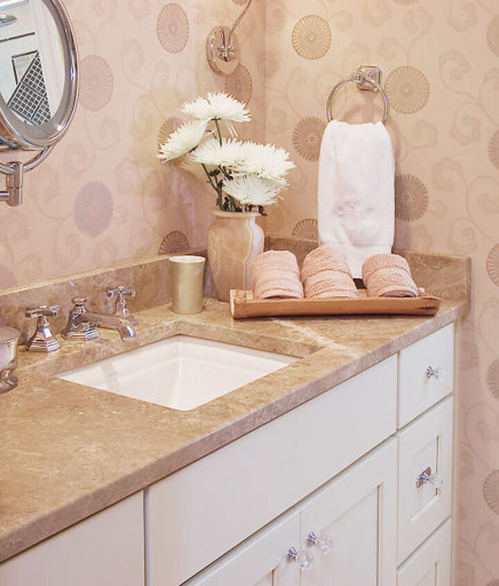 The vanity area with granite, undermount sink and wall paper