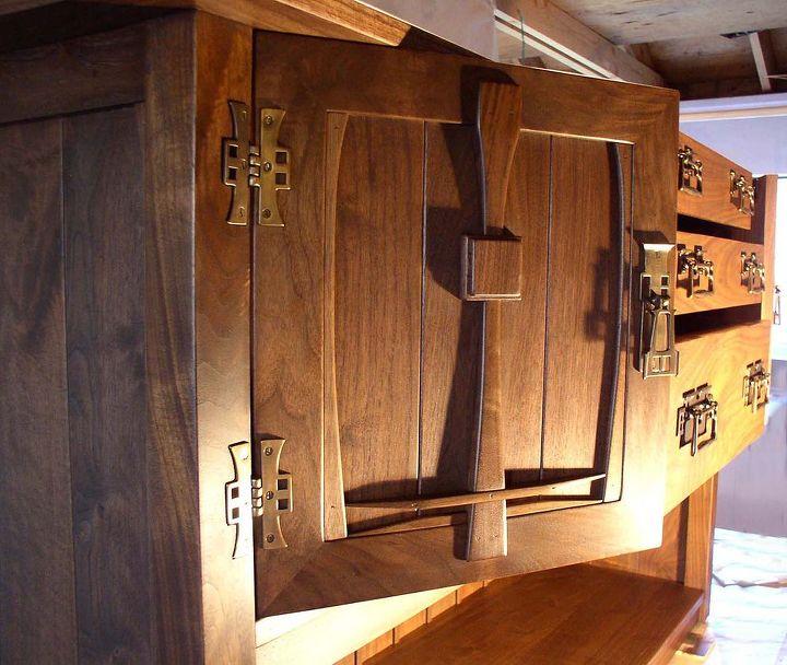 A shaped walnut door with C. R. Mackintosh hardware
