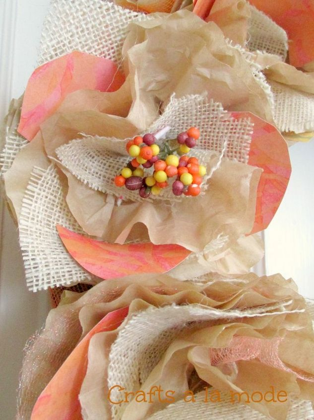 fall burlap and coffee filter wreath, crafts, repurposing upcycling, seasonal holiday decor, wreaths, And some half circles of orange colored scrap booking paper to give each rose some pizzazz