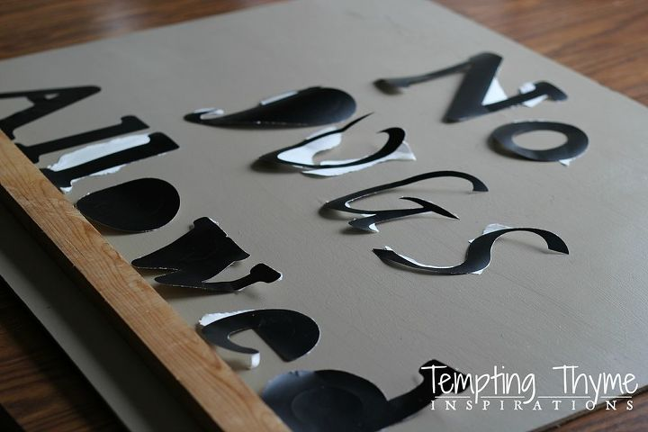 I used a Cricut to cut out the stenciled letters and placed them onto a previously painted wooden board.