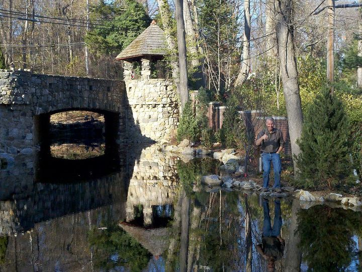 Reflecting on the job Large pond with stone bridge and turret with awesome reflection built on Long Island by Deck and Patio Company www.deckandpatio.com