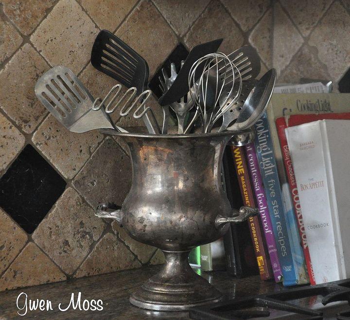 I keep my kitchen utensils inside an old trophy.