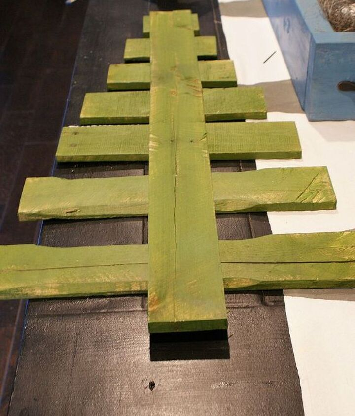 diy pallet christmas tree tutorial, christmas decorations, pallet, repurposing upcycling, seasonal holiday decor, After painting the boards lay the trunk down on the boards to get the spacing you want