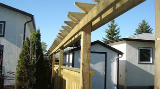 q i want to build a pergola, diy, outdoor living, woodworking projects, We liked the pergola out front so much we built a fence a couple of years later to replace the existing good neighbour fence