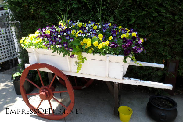 Farm cart planter. I love it! http://www.empressofdirt.net/more-garden-container-ideas/