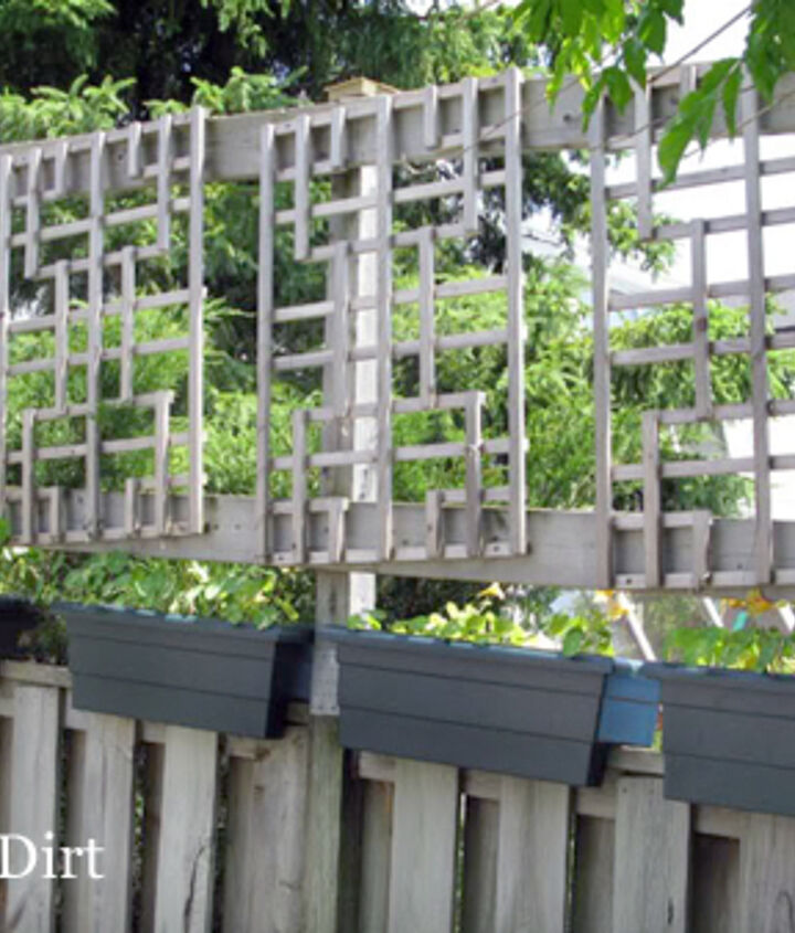 You can make a fence taller! Here the fence posts were extended and lattice was added. Vines will eventually fill it in.