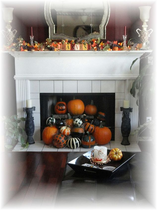 Warming up the fireplace with these fun pumpkins spilling out is certainly a fun way to celebrate the season!
