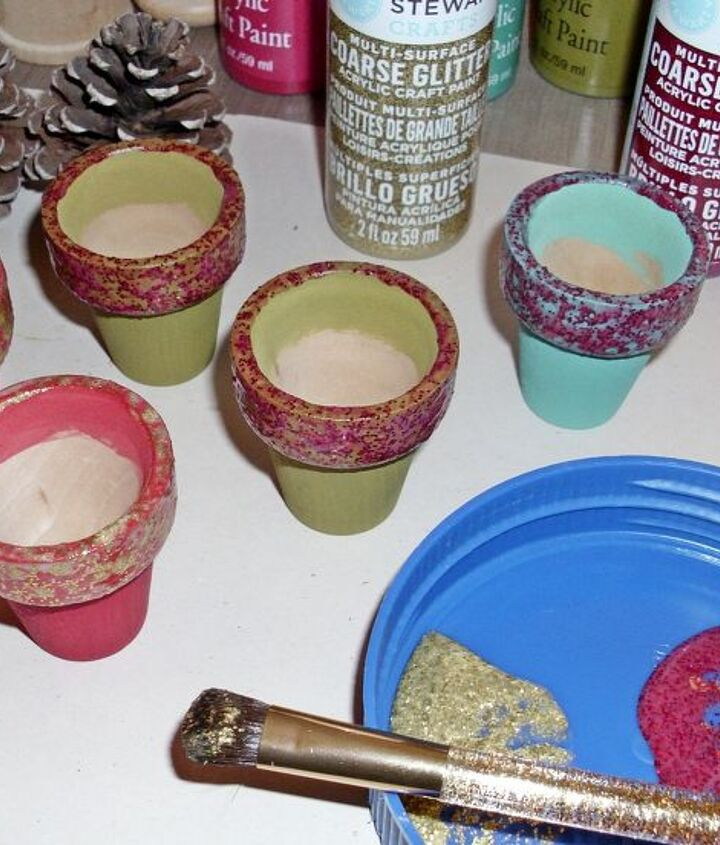 Paint the tiny pots, add course glitter paint, place pinecones in the pots. Easy!