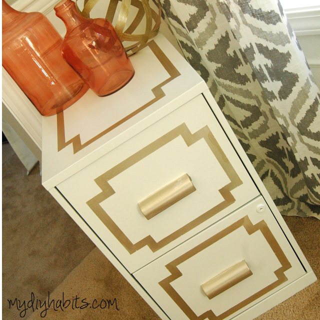 AFTER:  This File cabinet is such a simple upgrade from the original boring piece.   The change was completed with primer, painting tape, gold paint and White Dove Advanced Paint.