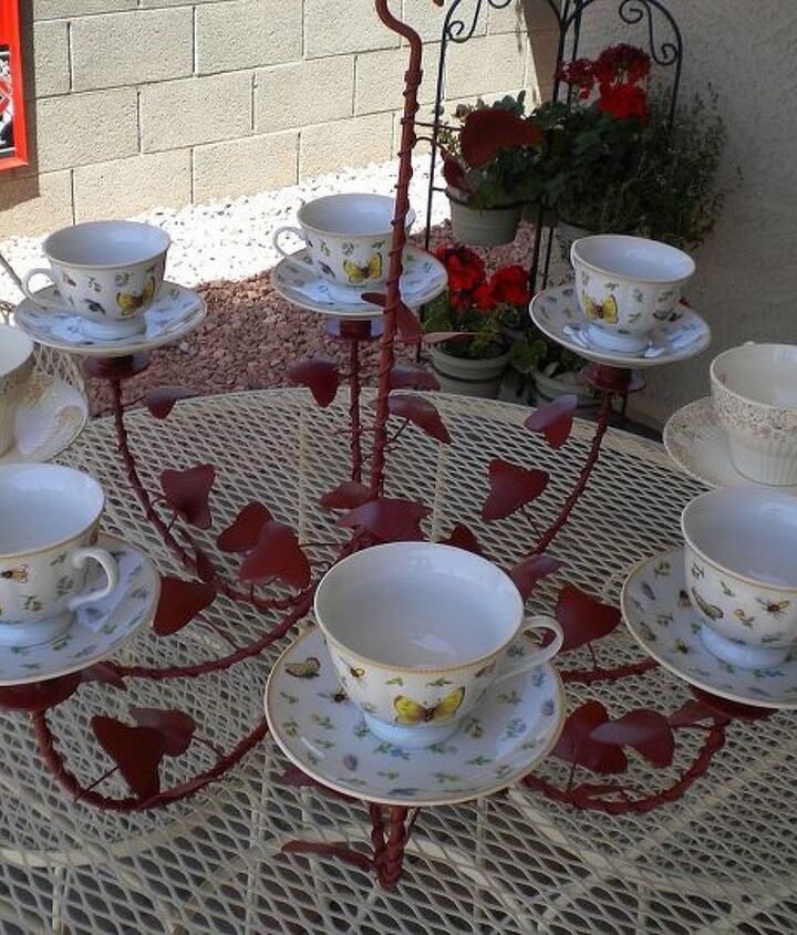 Repurposed chandelier, painted and attached tea cups and saucers.