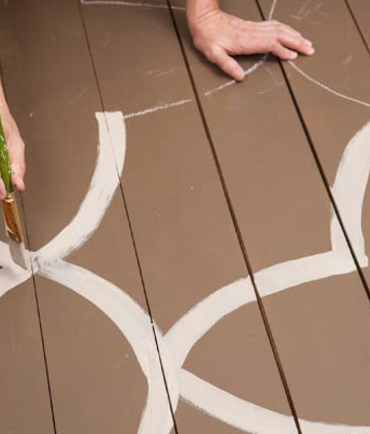 Using a 1½-inch painter's brush—and taking care not to paint yourself into a corner—go over the chalk lines with a stain in a contrasting color. Aim to let the floorboard edges run through the centers of the lines.