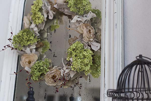 Romantic wreath on a vintage French mirror