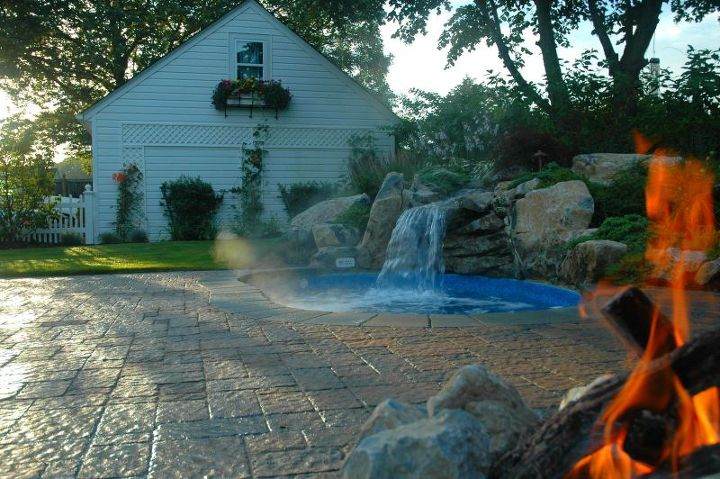 """Spool"" with waterfall, gas fire pit and tumble paver patio. Pool and spa in one. http://www.deckandpatio.com/DP_Blog/?p=1105"