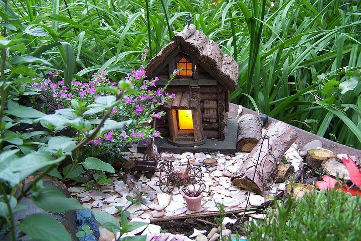 """Plenty of little items to make the fairies feel """"at home"""". P. S. The fairies sometimes leave shiny coins for the grand kids."""