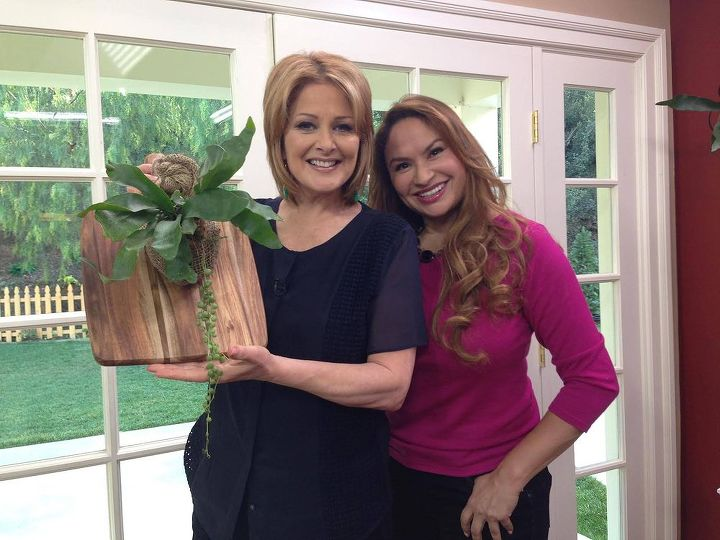 Cristina Ferrare, host of Home & Family and Shirley Bovshow with Shirley's design for Staghorn fern.