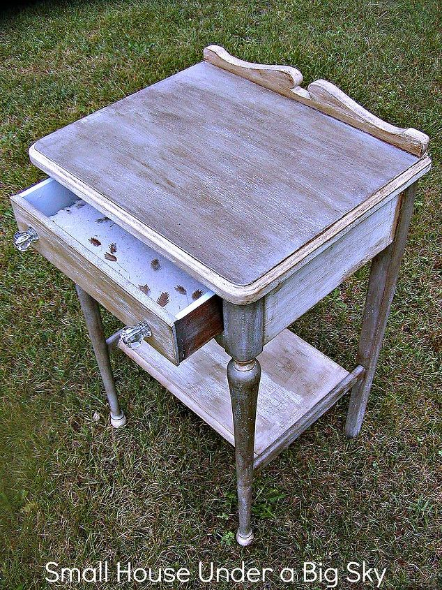 This barn sale table was repurposed using chalk paint with dark wax directly over it to create a metallic looking finish and my handmade paper drawer liner.