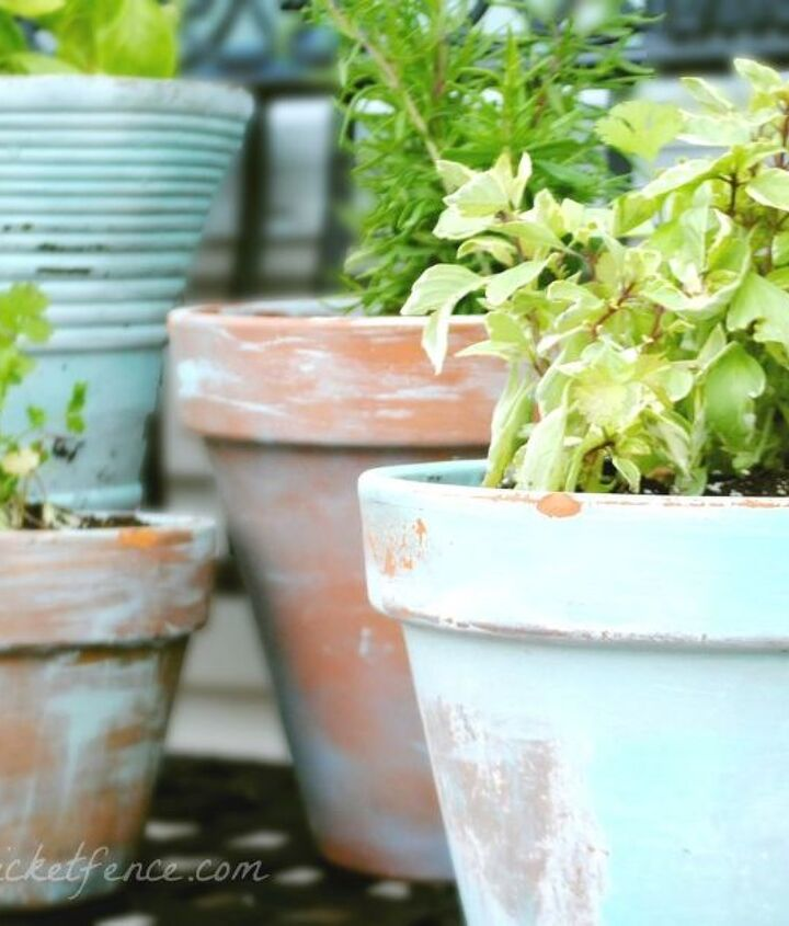 Some paint, a paint brush and a hammer is all it takes to age boring terra cotta pots.