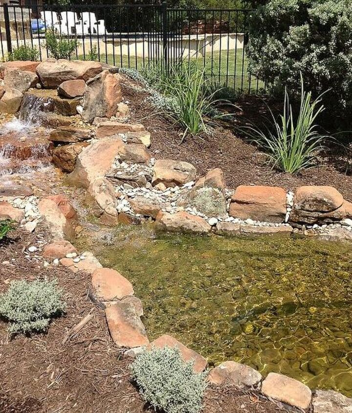 Natural Rock Waterfall and pond with native landscaping near Austin, TX