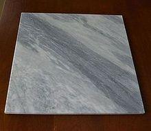 q help me identify this stone, concrete masonry, tiling
