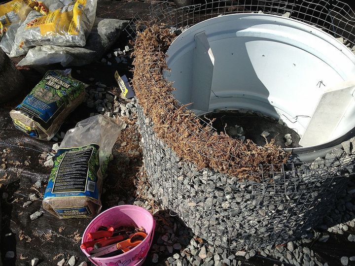 The top edge is finished with long-cut peat moss that will be a growing medium for trailing succulents.