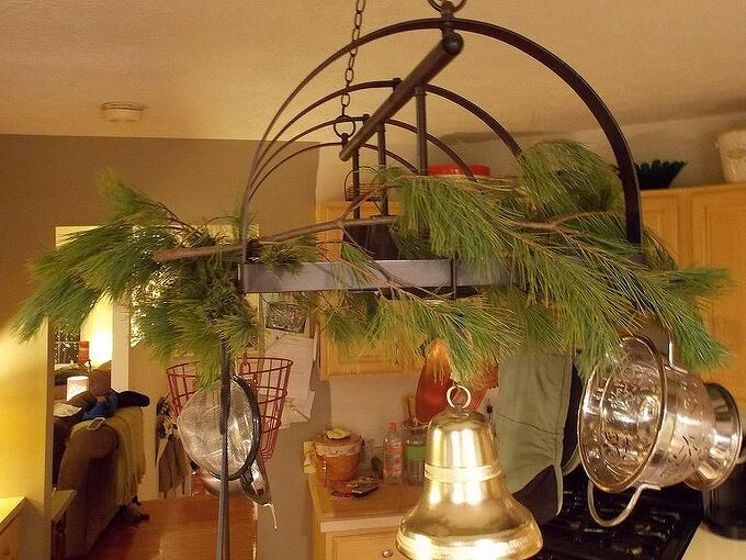 using fresh pine as holiday decor, seasonal holiday d cor, Drape branches across pot rack light fixture Use wire to attach if needed
