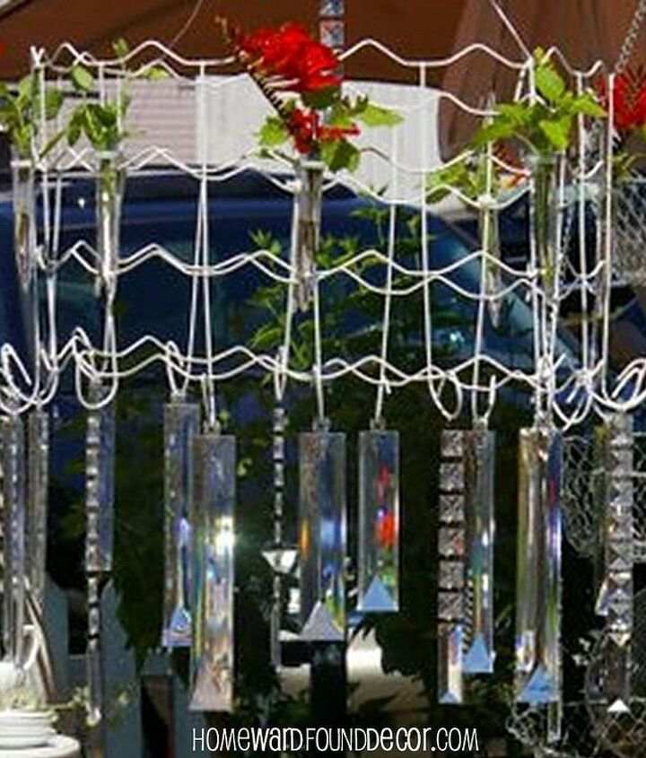 Test tubes hold flower stems or tall, thin candles. http://homewardfounddecor.blogspot.com/2013/05/a-garden-fence-chandelier.html
