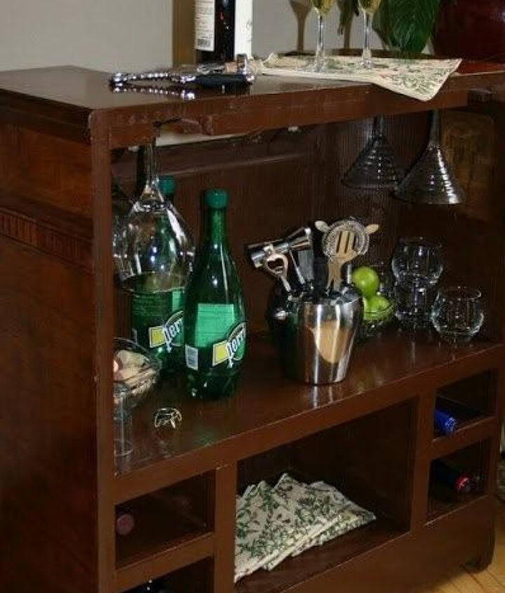 Mini bar in the back!  We added casters so it can easily be moved to wherever we need it.  It has built in stemware holders and wine storage, plus shelving for all of the extras.