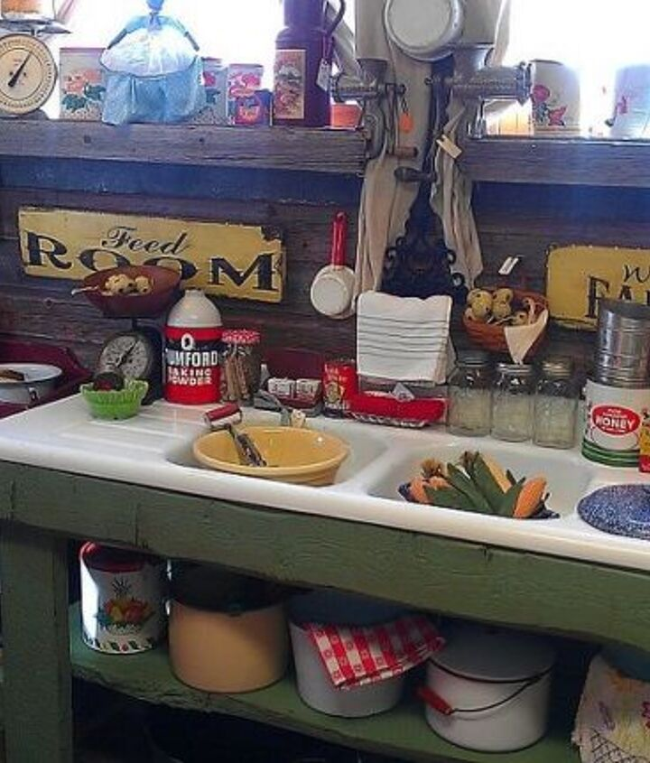 A fun old kitchen sink repurposed into a potting bench with rough boards.  Here it is in the shop!