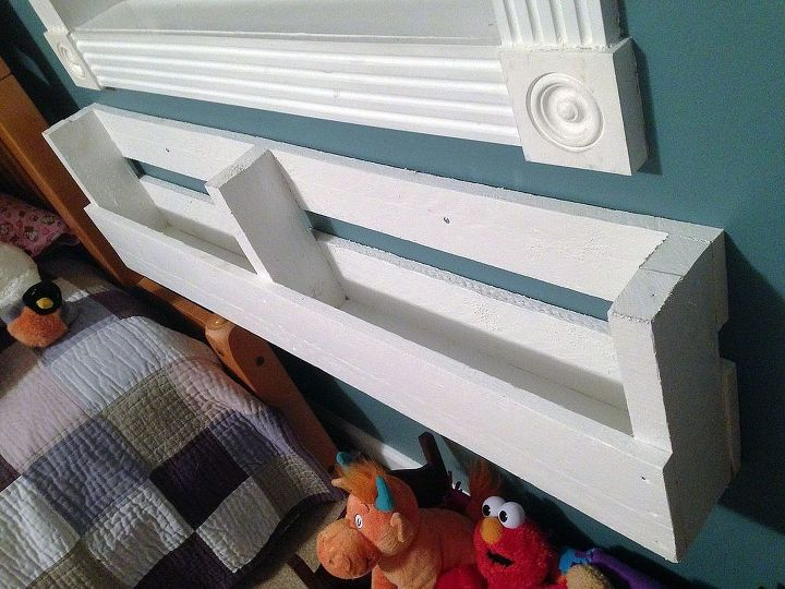 Hang the Shelves. I chose to use a screw in wall anchor where there were no studs and a 2″ screw where there was one.